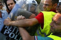 In Greece, It's The Police Vs The Riot Police
