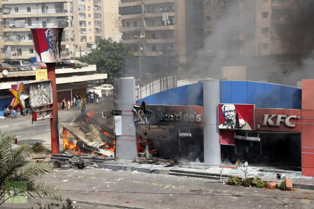 Hardee's and a Kentucky Fried Chicken fast food outlet burns after protesters set the building on fire in Tripoli, northern Lebanon