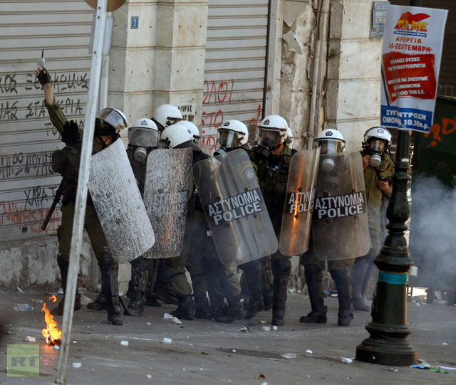 riot-police-officer-throws