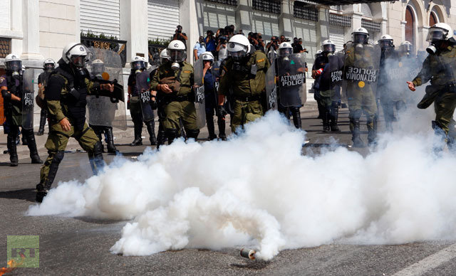 teargas-explode-riot-police
