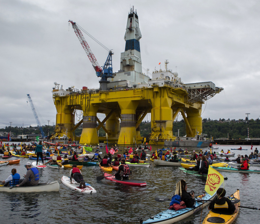 Shell Oil Abandons Arctic Oil and Gas Exploration - Environmental Disaster Avoided Activists in kayaks protest the Polar Pioneer, Shell's giant oil rig, which is moored at the Port of Seattle's Terminal 5 on May 16, 2015.