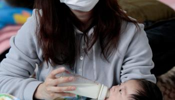 a-mother-feeds-her-baby-at-an-evacuation-center-in-yamagata-prefecture-northern-japan-thursday-march-24-2011-hundreds-of-thousands-remain-homeless-squeezed-into-temporary-shelters-witho