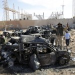 A convoy of Gaddafi loyalists' vehicles is pictured destroyed and littered with bodies near Sirte October 20, 2011. Gaddafi was killed on Thursday as Libya's new leaders declared they had overrun the last bastion of his long rule, sparking wild celebrations that eight months of war may finally be over. Details of the death near Sirte of the fallen strongman were hazy but it was announced by several officials of the National Transitional Council (NTC) and backed up by a photograph of a bloodied face ringed by familiar, Gaddafi-style curly hair. REUTERS/Thaier al-Sudani (LIBYA - Tags: CONFLICT CIVIL UNREST POLITICS)