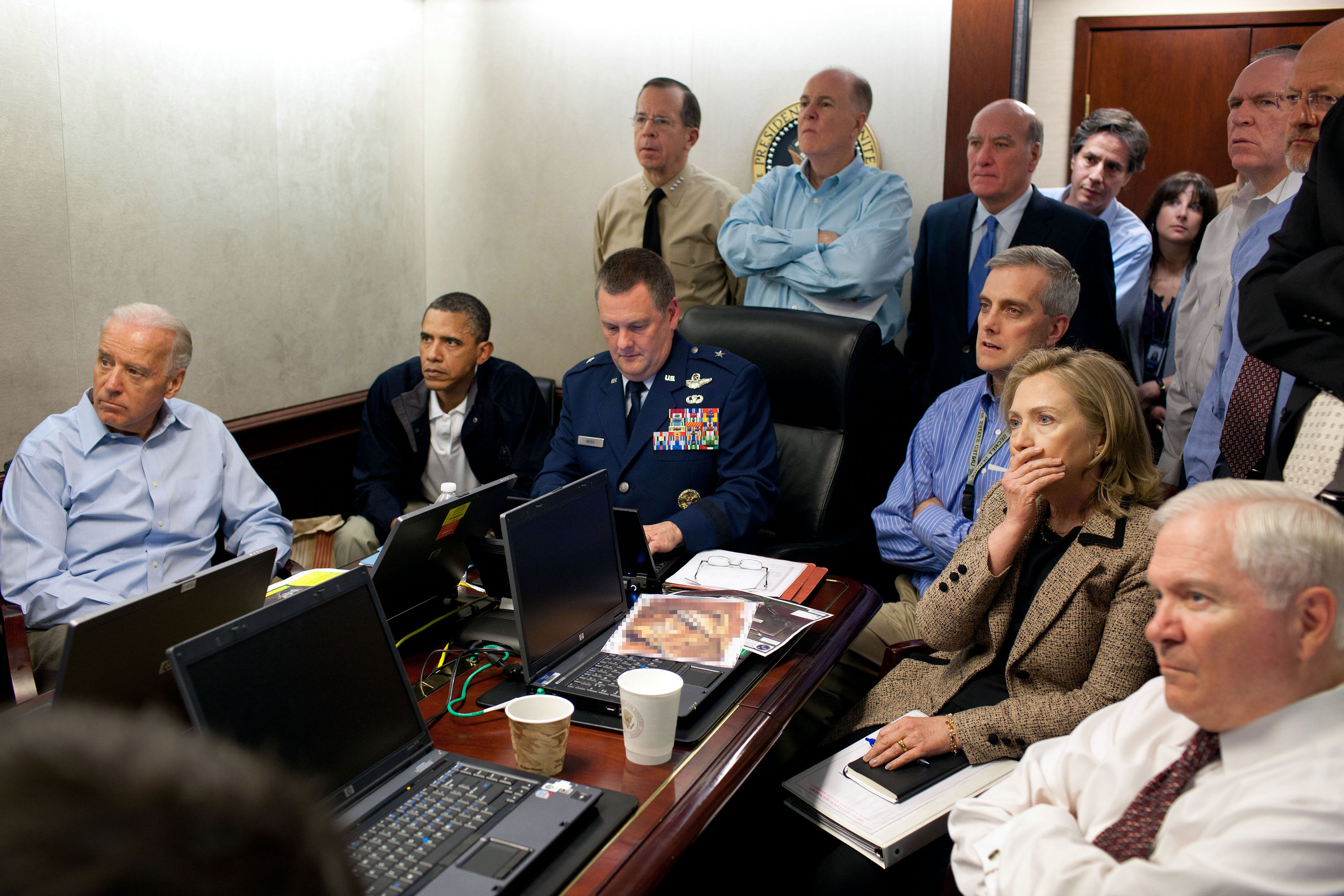 President Barack Obama and Vice President Joe Biden, Secretary of State Hillary Clinton, along with with members of the national security team, receive an update on the mission against Osama bin Laden in the Situation Room of the White House, May 1, 2011. Please note: a classified document seen in this photograph has been obscured. (Official White House Photo by Pete Souza)